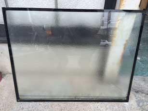 市川市の複層ペアガラス水たまり